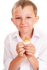handsome boy with a chicken in hands
