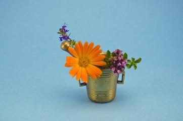 medical flowers in vintage brass mortar