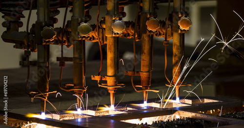 CNC LPG cutting with sparks close up - 69704212