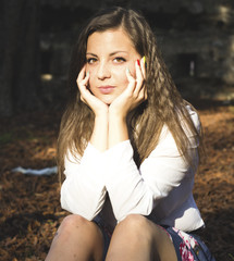 Beautiful young hispanic woman in autumn park