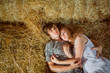 Young boy and gyrl lying in hay