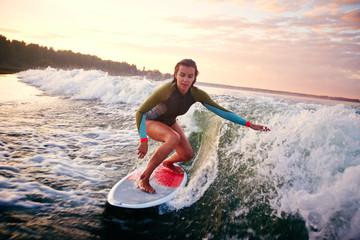 Woman surfboarding