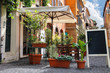 Tables outdoor cafe on a narrow street in Rome, Italy