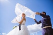 Leinwandbild Motiv Newly wed couple dancing next to a lake