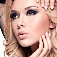beautiful woman with  dark makeup of eyes