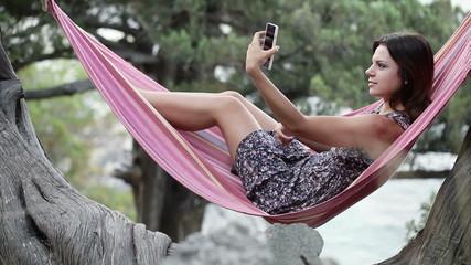Girl in hammock smartphone self