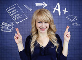 Fototapety Student crossing her fingers, hoping for best, good grades
