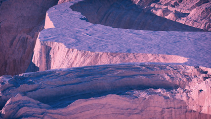 Aerial of winter snow mountain landcape at sunset.