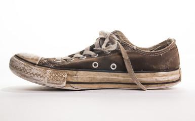 Dirty tennis shoe side view