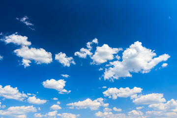 Cloudscape background of bright blue sky