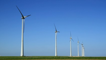 Two modern wind turbines generating sustainable energy