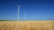 Two modern wind turbines generating sustainable energy.