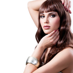 Beautiful young woman with long brown hairs.