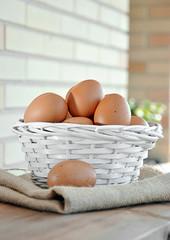 eggs in a white wicker basket