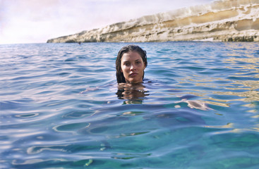 beautiful woman swimming in the sea