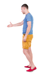 Back side view of man  in shorts handshake.