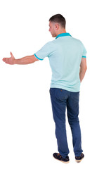 Back side view of man  in shirt handshake.