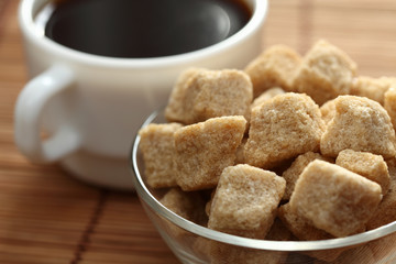 Coffee cup and brown cane sugar