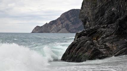 Sea waves break about rocks
