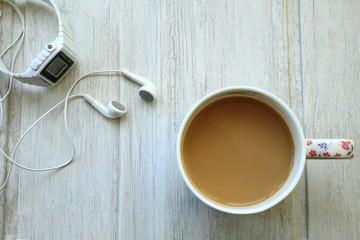 Coffee and headphones