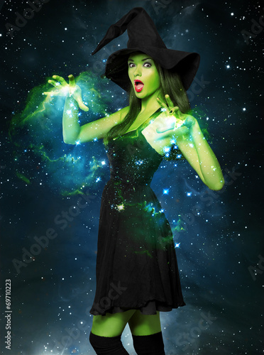 canvas print picture Beautiful young woman as halloween witch