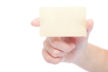 Beautiful female hand holding a gold blank card.