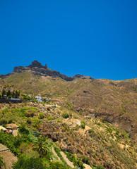 Roque Nublo seen over Tejeda village
