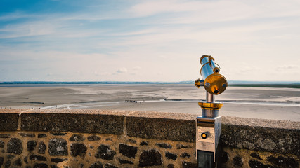 Mont Saint Michel terrace with binoculars with view over the sea