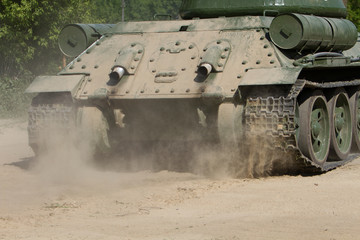 Rear view of moving old russian tank