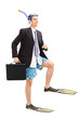 Businessman walking with scuba fins