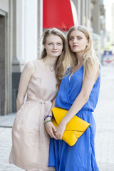 Two young women walking in the summer city