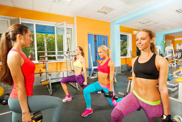 Portrait of girls doing exercises in gym
