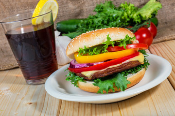 hamburger and drink with slice of lemon