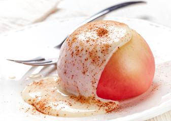 baked apple dessert with vanilla sauce