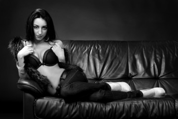 Brunette in fur on the couch