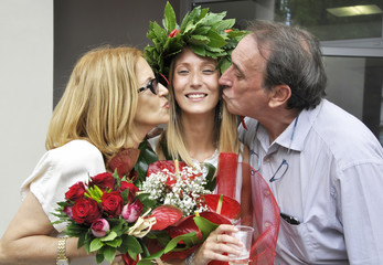 Young girl celebrating degree with her parents