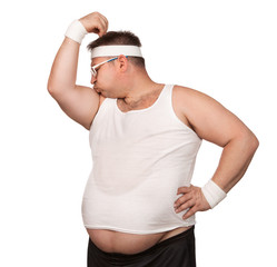Funny overweight sport nerd kissing his bicep isolated on white