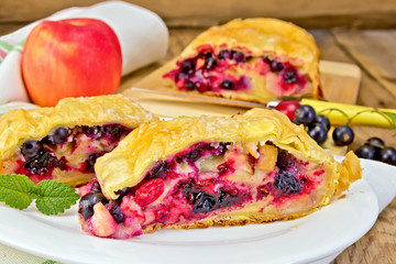 Strudel with black currants and apples on board