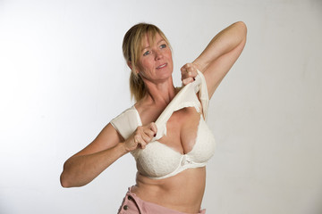 Woman getting dressed pulling shirt over her head