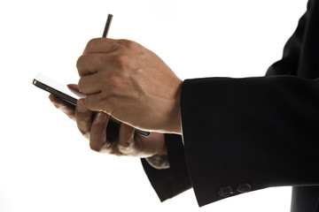 Hands of Businessman with stylus touching the screen of smart ph