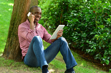 African man with smart phone and tablet