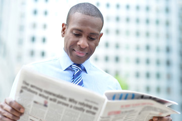 Corporate man reading news at outdoors