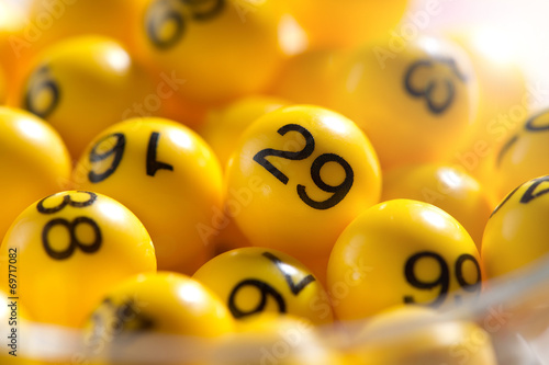 Background of yellow balls with bingo numbers плакат