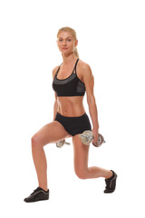 Sexy athletic blonde girl with dumbbells