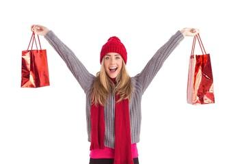 Festive blonde holding shopping bags
