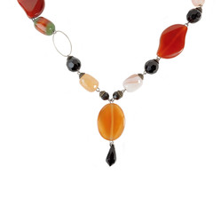 Necklace of semiprecious stones isolated on white