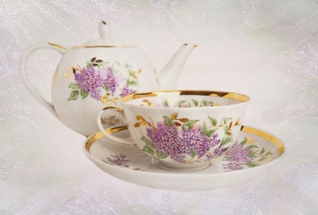 Porcelain teapot,teacup,saucer with floral ornament