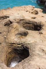 Holes dug in rock