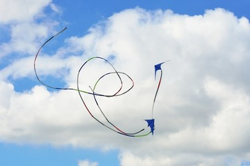 Two kites flying in formation