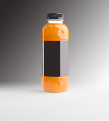 Orange juice in bottle with blank label